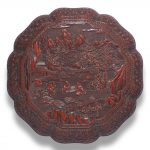 A carved cinnabar lacquer eight-lobed box and cover