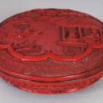 A GOOD QUALITY 19TH/20TH CENTURY CHINESE RED CINNABAR LACQUER CIRCULAR BOX & COVER