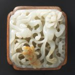 A fine white and russet jade openwork plaque Ming Dynasty