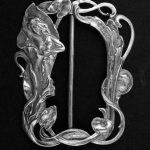 Cast silver-gilt waist buckle in the form of a nymph amongst water-lilies. William Comyns