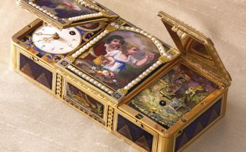 THE CHERRY PICKERS AN EXCEPTIONAL THREE COMPARTMENT GOLD ENAMEL AND PEARL MUSICAL SNUFF BOX